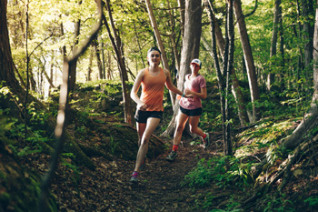 Chloe (front) and Brittany (back) on a training trail run at Lone Rock Pont in Burlington, VT. They are preparing to race in the Catamount Ultra 25K/50K on June 22. Photo: Zach Walbridge.