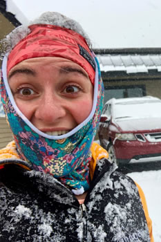 Emily staying warm in her Patagonia R1 (and Skida hat and neckwarmer) on a snowy day.