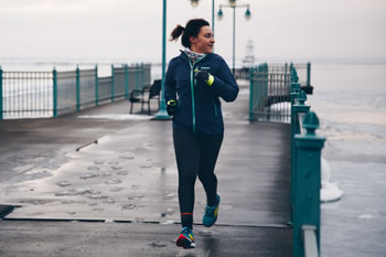 Emily running in her Salomon Sonic RA running shoes and staying warm in her Patagonia Stretch Rainshadow Jacket. Photo Credit: Zach Walbridge.