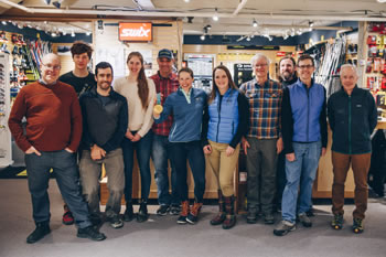 Kikkan Randall (exact center) visits Skirack the day after the event at Sleepy Hollow. Pictured: the cross country ski staff; Marisa Rorabaugh, the author (fourth from left). Photo: Zach Walbridge