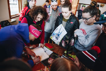 Kikkan Randall signs autographs at Sleepy Hollow Inn Bike and Ski Center. Photo: Zach Walbridge