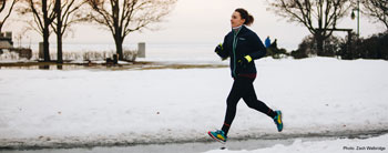 Emily runs along the Burlington, VT waterfront in February, while training for the Vermont City Marathon. Photo credit: Zach Walbridge.