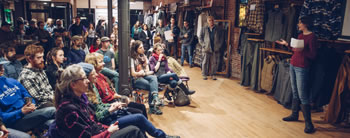"The crowd watches the film premier of ""Riparian"" at Patagonia Burlington. Photo credit: Zach Walbridge."