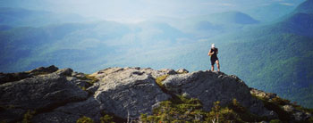 Skirack's Brendan trail running along Camel's Hump peak. Photo Credit: Liam John.